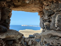 Stone frame or window looking at a Greek Sea in Balos, Gramvoussa during a summer sunny day with clear sky