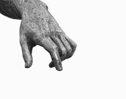 stone hand extended pointer finger down, fragment of old sculpture. symbol of attention, warning. Arm statue on white background. white-black color. copy space