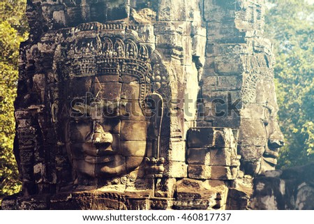 Stone heads which form part of the Bayon Temple in Angkor Thom, near Siem Reap, Cambodia. Vintage filter effect added.