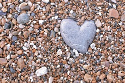 Stone heart with pebble