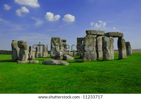 Stone henge with green grass and blue sky