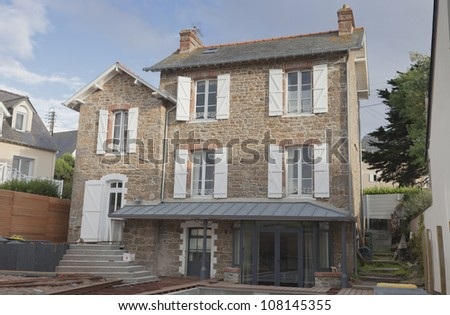 Stone house in Brittany with work on wooden terrace in progress - Saint-Malo, Brittany, France