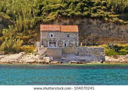 Stone house on the beach in dalmatian Island of Susak, Croatia