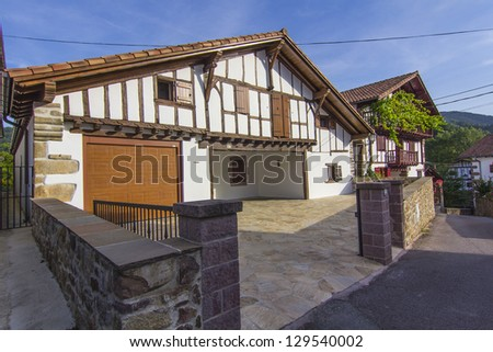 Stone houses and ornate wood very typical in the beautiful village of Etxalar, Spain #129540002