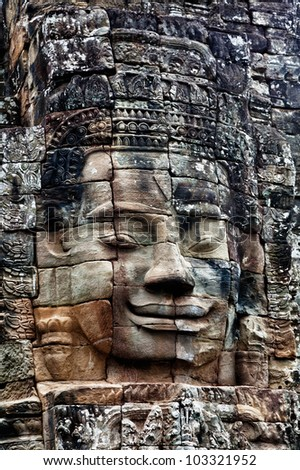 Stone  image of Buddha in the temple of Angkor Thom.
