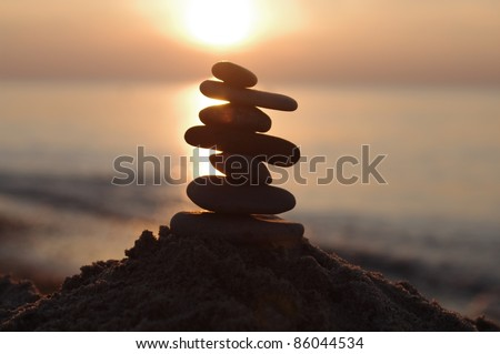 stone in  sand on sunset   background