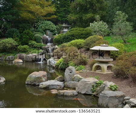 Stone lanterns and small waterfall with koi fish and koi for Your pond japan