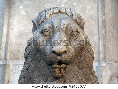 Stone lion gate decoration. Lion decoration made of stone.