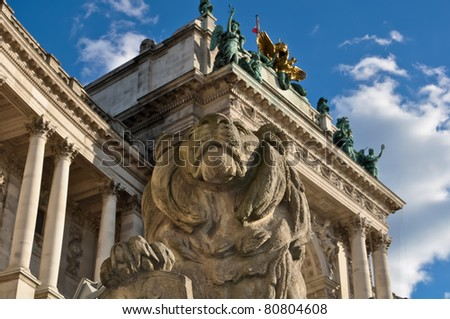 stone lion sculpture guarding vienna's national library
