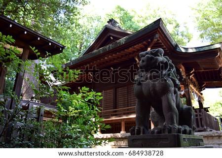 Stone lion statue at Japanese shrine.