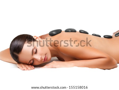 Stone Massage Beautiful Woman Getting Spa Hot Stones Massage in Spa Salon