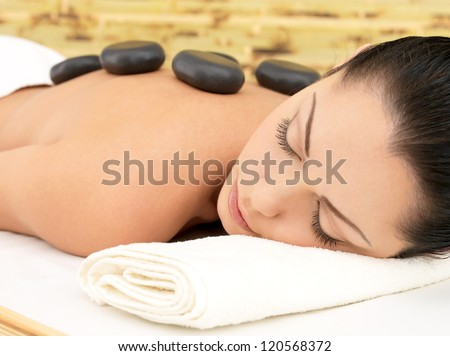 Stone massage for young woman at beauty spa salon Recreation therapy