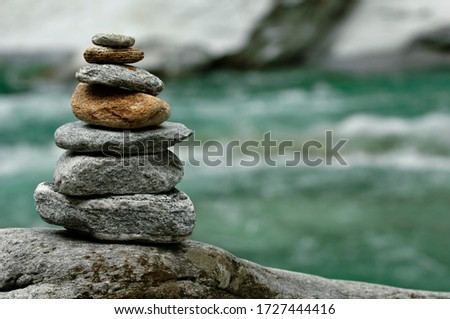 Photo of  Stone men, cairns at the Verzasca River, Valle Verzasca valley, Ticino, Switzerland, Europe