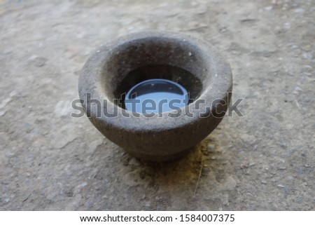 Stone mortar is a type of cookware Which is used to make food. on Thailand #1584007375