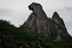 Stone mountain Quixadá Monoliths Natural Monument, formation of inselbergs at Ceará, Brazil, nature reserve. Chicken form, Broody Hen curious rock at Cedro Lake dam. Climbing travel destination.