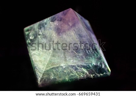 Stone of a fluorite in the contrast light #669659431