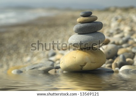 stone on stone, a top of the together sand to the sea...