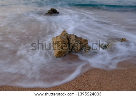 Stone on the shore of the sandy shore #1395524003