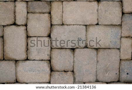Stone or block-patterned street or road or walkway or wall.