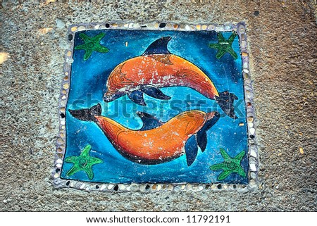 Stone ornament with dolphins. Shot in Sodwana Bay, KwaZulu-Natal, South Africa and Southern Mozambique.