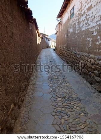 Stone passageway in San Blas, Cusco, Peru.   #1554167906