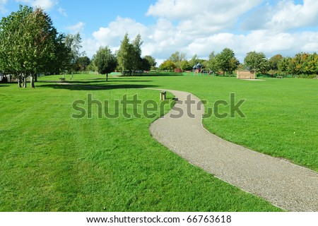 Stone Pathway in a Lush Green Park