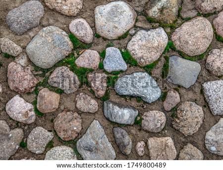 Stone paved wall background view
