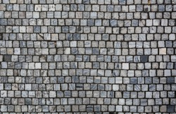 Stone pavement texture. Granite cobblestoned pavement background. Abstract background of old cobblestone pavement close-up. Seamless texture. Prague