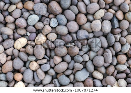 Stone pebbles texture background for interior exterior decoration and industrial construction concept design.