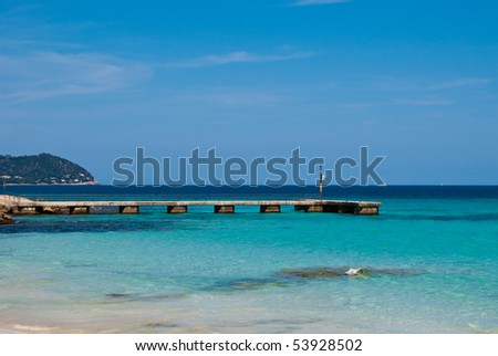 Stone pier and transparent waters of Mediterranean Sea on Majorca island in Spain