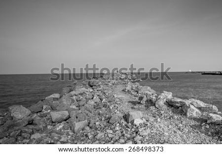 Stone pier at Thailand sea black and white