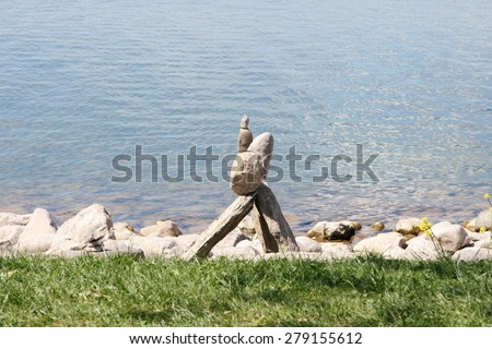Stone pile of natural stone, water surface in background