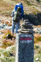 Stone pillar with red-white marking of the tourist route