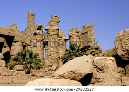 Stone pillars against the blue sky in the Temple of Karnak Luxor Egypt