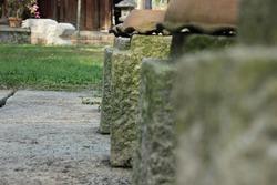 Stone pillars form a corridor for the garden path