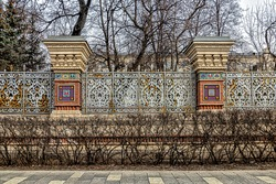 Stone pillars of the fence of the merchant's estate are decorated with mosaics, carvings on white stone, and figured metal fence