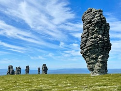 Stone pillars of weathering on the Manpupuner mountain plateau in the Komi Republic in Russia in summer in clear weather