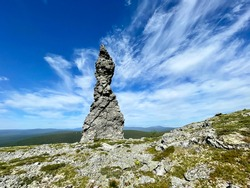 Stone pillars of weathering on the Manpupuner mountain plateau in the Komi Republic in Russia in summer.  Rock Queen