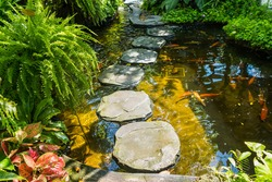 Stone platform, walkway across the garden fish pond