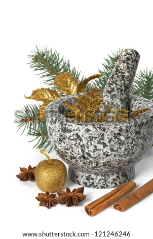 Stone pounder with star anise and cinnamon on a white background