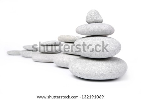 Stone pyramid over white