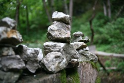 Stone pyramids in the green jungle. Ecological buildings of ancient civilizations. Towers made of textured old stones. Contemporary art in the forest