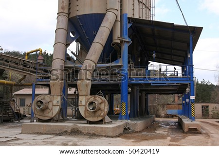 Stone quarry with silos and turbines
