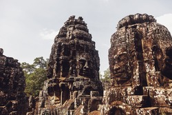 Stone ruins of Angkor Wat temple complex largest religious monument and UNESCO World Heritage Site. Ancient Khmer architecture with stone murals and sculptures. Amazing travel to Siem Reap, Cambodia