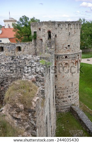 Stone ruins Vedensky castle in the town of Cesis on the background of blue sky