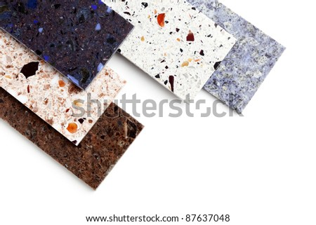 Stone samples for kitchen worktops on white background.