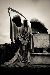 Stone Sculpture of Grim the Reaper [Death Taker or Angel of the Death], Processed in Dark Sepia with Grained and Vignette Effect. Halloween concept. Halloween sculpture.