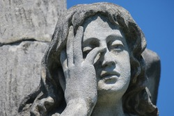 Stone sculpture on the grave in a Christian cemetery