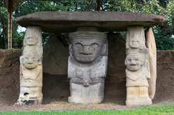 Stone sculpture or anthropomorphic statue in a tomb from ancient pre-hispanic indigenous cultures in the Archeological park of San Agustin. Zoomorphic design