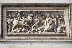 Stone sculptures of humans and a horse on the Arc de Triomphe in Paris, France